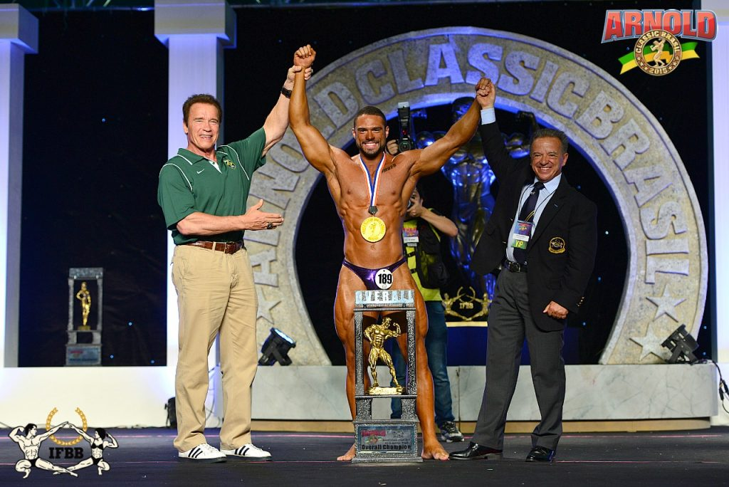 Men's Classic Bodybuilding overall winner Renan Esposito (Brazil) congratulated by Gov. Arnold Schwarzenegger (left) and IFBB President Dr. Rafael Santonja (right).